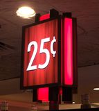 25 cent lighted sign. View of red lighted 25 cent sign on a casino floor stock photo