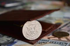 50 cent mynt i plånbok royaltyfri foto