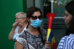 Centaines blessées dans des protestations de la Roumanie photo stock