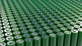 Centaines de batteries vertes toutes dans une rangée image libre de droits