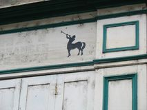 Centaur on a wooden pane. A centaur painted  on a wooden pane above ann old shop in France Royalty Free Stock Photo