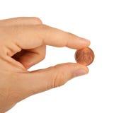 centavo euro 2 entre los fingeres Imagen de archivo