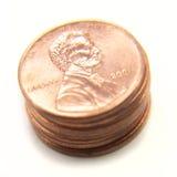 Centavos americanos isolados na moeda de um centavo branca do â Imagens de Stock