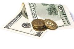Centavos y cuentas de papel del ciento-dólar Imágenes de archivo libres de regalías