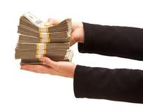 Centenas cedendo da mulher de dólares fotografia de stock royalty free