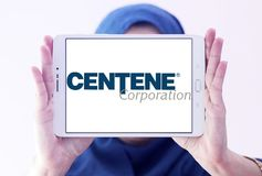 Centene Corporation logo. Logo of Centene Corporation on samsung tablet holded by arab muslim woman. Centene Corporation is a large publicly-traded company and a royalty free stock photo