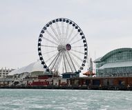 Centennial Ferris Wheel. This is a Winter picture of the iconic Centennial Ferris Wheel as seen across the ice on the Harbor area of Navy Pier on Lake Michigan stock images