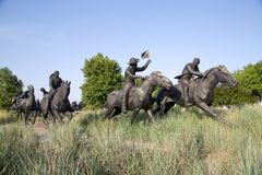 Centennial Land Run Monument group sculpture in Oklahoma view. Group bronze sculpture in Centennial Land Run Monument sunset, city Oklahoma USA stock image