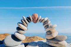 In center of arc. Red round stone in center of arc of the pebbles Royalty Free Stock Photography