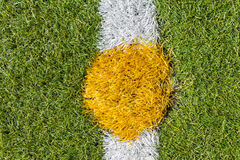 Center of artificial grass soccer pitch. Center of  artificial grass football (soccer) pitch or indoor futsal pitch Royalty Free Stock Photos
