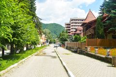 The center of the balneary thermal water resort Baile Olanesti with hotels, guest houses and green parks in a beautiful summer day. Romanian travel destination royalty free stock photo