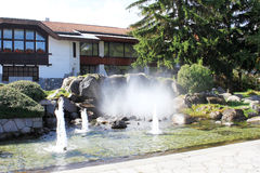 Center of Bansko. View of fountains and pine trees in the center of Bansko. Bansko is a town in southwestern Bulgaria, located at the foot of the Pirin Mountains Royalty Free Stock Images