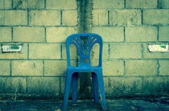 Center Blue Chair on Concrete Block Background Royalty Free Stock Image