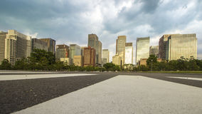 Center of business area in Japan with high rise building. On cloudy sky Royalty Free Stock Images