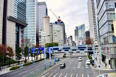 Japan Osaka business district office buildings and clean road. Center business district of Osaka Japan, exquisite gray office buildings and clean road in a sunny Royalty Free Stock Photo