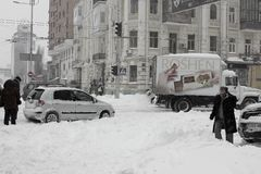 The center of the city, paralyzed by the snowfall and the drivers, help each other. The central part of the city, the capital of Ukraine, is paralyzed by stock images