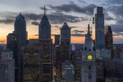 Center City Philadelphia Sunset. Sunset over Center City Philadelphia with city hall clock tower and William penn statue Stock Photo