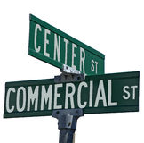 Center & Commercial. A street sign, denoting the intersection of Center St and Commercial st, isolated with a white background. any different background could be stock images