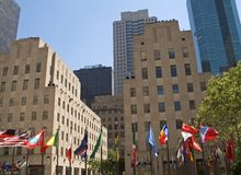 Center Flags. This is a view of the flags and buildings at the center of Rockefeller Center royalty free stock image