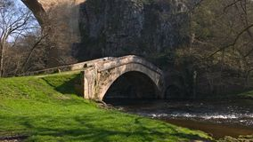 Old stone bridge forgiven passing upon a river stock image