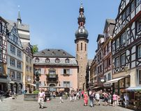 Center of German medieval city Bernkastel with shopping tourists Royalty Free Stock Photo