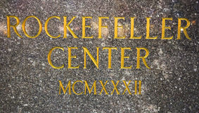 center guldrockefeller tecken Arkivbild