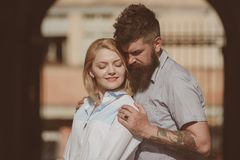 She is the center of his universe. Couple in love. Bearded man hug girl. Sensual woman and man enjoy romantic date. She is the center of his universe. Couple in royalty free stock photography