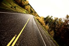 Center lines along a paved road Royalty Free Stock Image