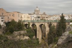 Center of Massafra town, Puglia. Bridge over he canyon in small beautiful town in South Italy Massafra, region Puglia Royalty Free Stock Photos