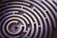 Center of a maze. Businessman at the center of a maze stock photography
