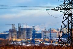 In the center of the picture we see the supports of high-voltage power lines, modern houses, roads, construction of buildings. In. Outskirts of Moscow.In the royalty free stock photos