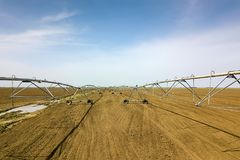 Center pivot irrigation system. Agricultural land, Aerial View. Royalty Free Stock Photography