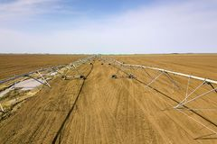 Center pivot irrigation system. Agricultural land, Aerial View. Stock Photo