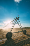 Center pivot irrigation system with drop sprinklers in field Stock Photo