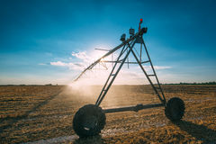 Center pivot irrigation system with drop sprinklers in field Stock Image