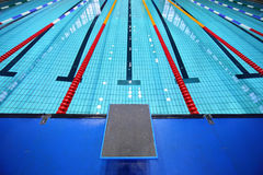 In center platform for start in swimming pool. In center one platform for start and lane of swimming pool Royalty Free Stock Photography