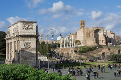 The center of Rome. Archeological area with Arch of Constantine, Temple of Venus and tourist Royalty Free Stock Photo