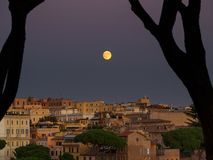 Center of Rome and full moon Royalty Free Stock Image