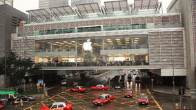 Center of sales of Apple electronics, movement of cars and people. stock video