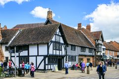 Stratford upon Avon, Warwickshire, England. The center and a shopping street with the public library Shakespeare`s birthplace Royalty Free Stock Photography