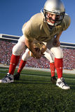 Center snapping football to quarterback Stock Image