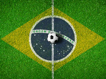Center of soccer pitch or field with flag of Brazil Stock Image