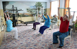 Center of social services for pensioners. Day of Health in Center of social services for pensioners and the disabled  gymnastics with sticks for eldery  in Stock Image