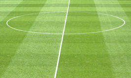 Center spot. Detail from a natural grass soccer field showing the center spot and circle royalty free stock image