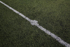 Center spot on a football pitch stock photography