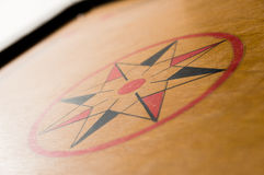 Center star on a wooden carrom board Royalty Free Stock Photo