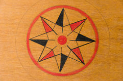 Center star on a wooden carrom board Royalty Free Stock Photography