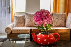 Center table with dotted vase plant in the dining area.  Stock Photos