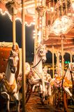 Festive decoration of Tirana city center. The center of Tirana decorated with lights for new year holidays defocused for bokeh. Carousel placed on the main Royalty Free Stock Image