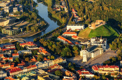 Center of Vilnius, Lithuania. Aerial view from piloted flying object. Center part of Vilnius, Lithuania in the sunset. Aerial view from piloted flying object Stock Photos